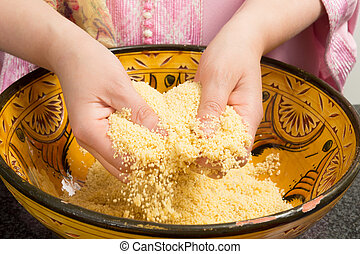 Cooking couscous - Traditional Moroccan immigrant woman in...