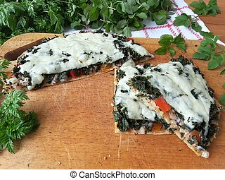 Cooking cow parsley goutweed pizza with mushrooms ginger and...