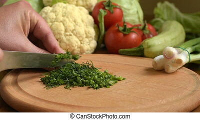 Cooking. Cutting fresh dill.