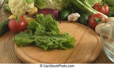Cooking. Cutting fresh lettuce. Cutting fresh vegetables....