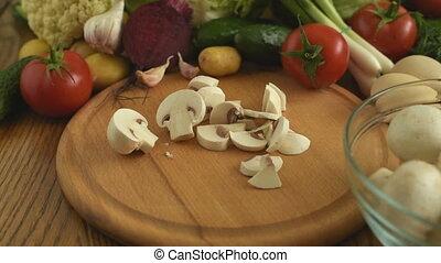 Cooking. Cutting mushrooms