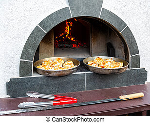 Cooking delicious pies in a Russian oven