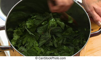 Cooking Down and Stirring Leafy Greens - Handheld, close up...