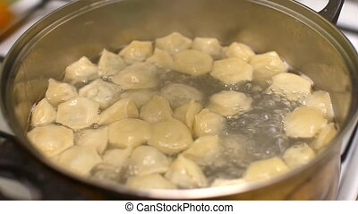 Cooking dumplings, put to boil in a pan of hot water on the stove