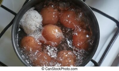Cooking egg in the food boiling water saucepan breakfast -...