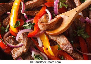 Cooking fajitas: beef with vegetables. macro horizontal -...