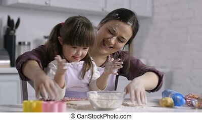 Cooking family stained with flour having fun - Carefree...