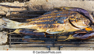 cooking fish on the grill