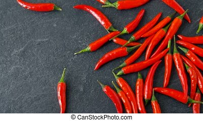 red chili or cayenne pepper on stone surface - cooking, food...