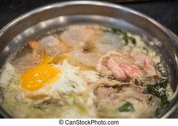 Cooking food in hot pot for make sukiyaki or shabu