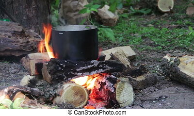 Cooking Food over a Campfire at the Tourist Pot