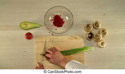 Top view of chef finely cuts red bell pepper