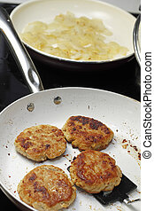 Cooking Four Turkey Patties and Onions