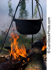 cooking fresh food at camp - cooking fresh food in cauldron...