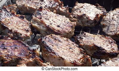 Cooking fresh juicy meat on grill barbecue.