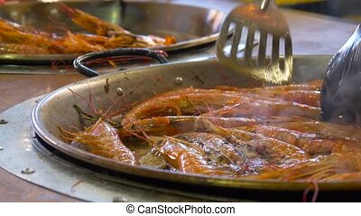 Cooking fried roasted shrimps in pan. Close up. - Chef is...
