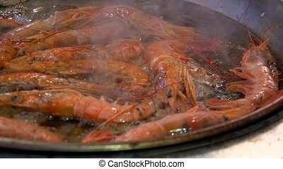 Cooking fried roasted shrimps in pan. Close up. - Shrimps...