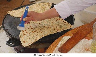 Cooking gozleme, traditional Turkish food