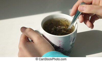 woman cooking a cup of green tea