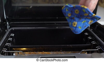 Cooking grilled steak ribeye in the oven with broiler top view