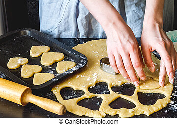 cooking homemade cookies with hands on dark background