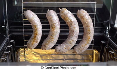 Cooking homemade roasted pork sausage on roasting rack in the oven top view