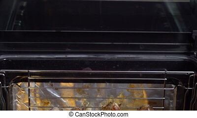 Cooking homemade roasted pork sausage on roasting rack in the oven top view.