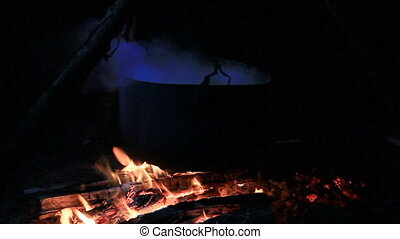 Cooking In Cauldron Over Fire.