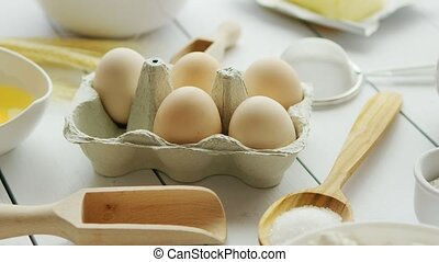 Cooking ingredients and tools around eggs - Closeup shot of...
