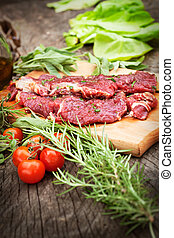 Cooking ingredients: marinated meat, oil, vinegar, herbs and...