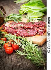 Cooking ingredients: marinated meat, oil, vinegar, herbs and...
