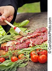 Cooking ingredients: marinated meat,oil,vinegar, herbs and...