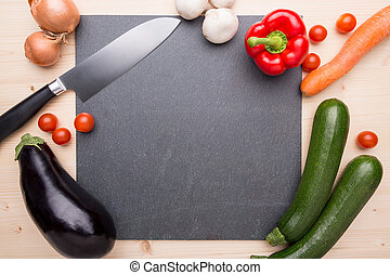 Cooking items on a plate of slate