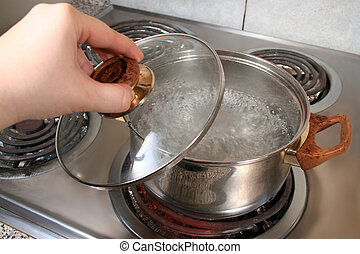 lifting lid of pot full of boiling water