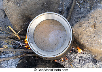 Cooking masala tea on a fire in the Thar desert near the town of Pushkar, Rajasthan India. Close up