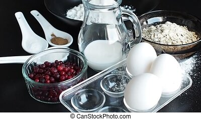 Cooking oatmeal cookies with cranberries. Ingredients for...