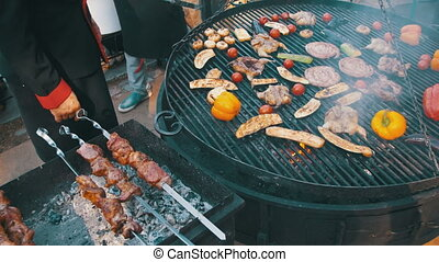 Cooking of Meat and Vegetables on the Grill