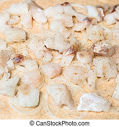 stuffing from raw fish pieces and onion rings