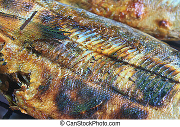 salted fish on a grill stove