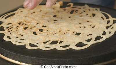 Cooking of traditional russian pancake. Close up - Cooking...