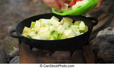 Cooking of vegetables in cauldron outdoors