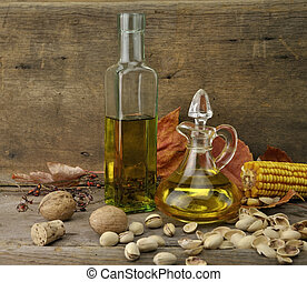 Cooking Oil And Autumn Items On Wooden Background