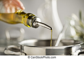 Cooking oil - Cooking meal in a pot. Bottle of Extra virgin ...