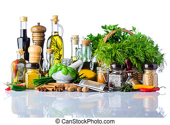 Cooking Oil, Herbs and Spices on White Background