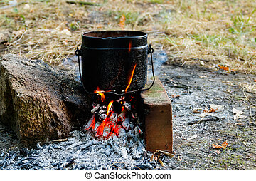 Cooking on campfire in camping