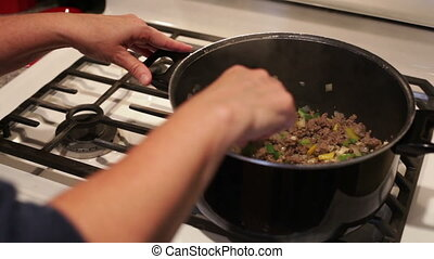 Cooking on kitchen stove. - Female chef cooking on kitchen...
