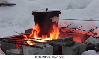 cooking on the fire. pan over an open flame