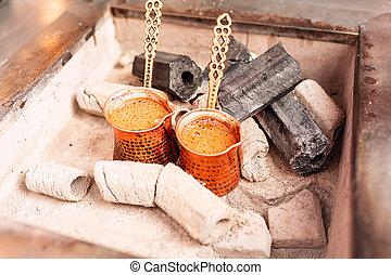 Cooking oriental coffee in a copper jezve pot in Istanbul, Turkey