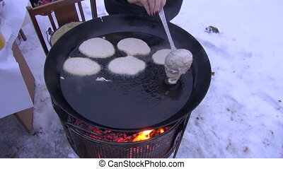 cooking pancake in winter end Tuesday festival. Pancake day