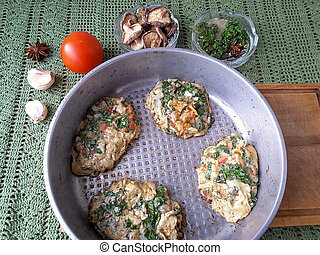Cooking pancakes dandelion leaves tomato mushrooms fritters...